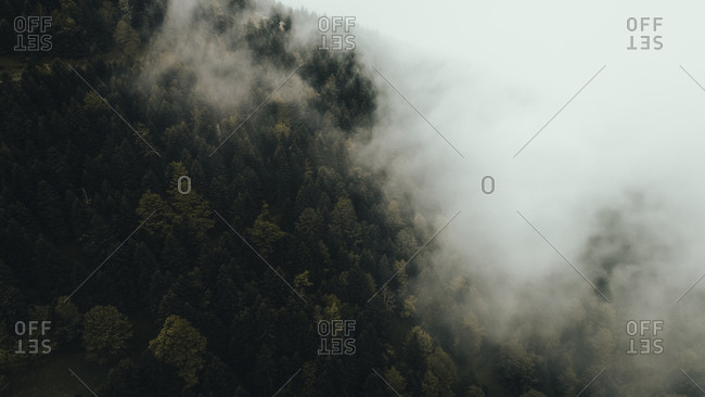 Elevated view of foggy French mountainside