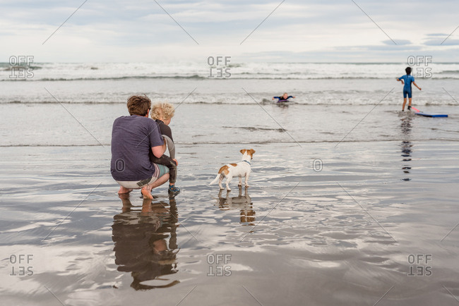 Family enjoying day with their dog on Hawke's Bay, New Zealand