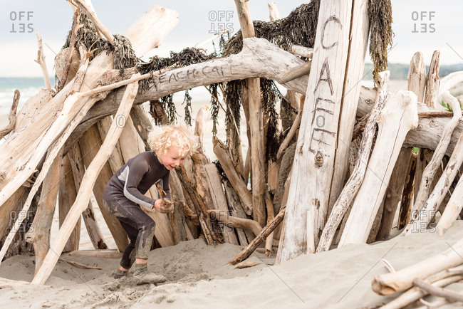 Young boy building a fort on beach