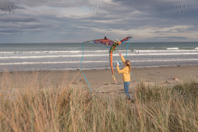Girl flying kite on Hawke's Bay, New Zealand