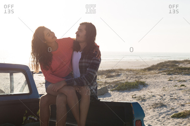 Couple romancing in a pickup truck at beach