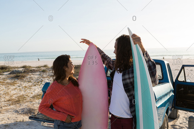 Couple interacting with each other in the beach on a sunny day