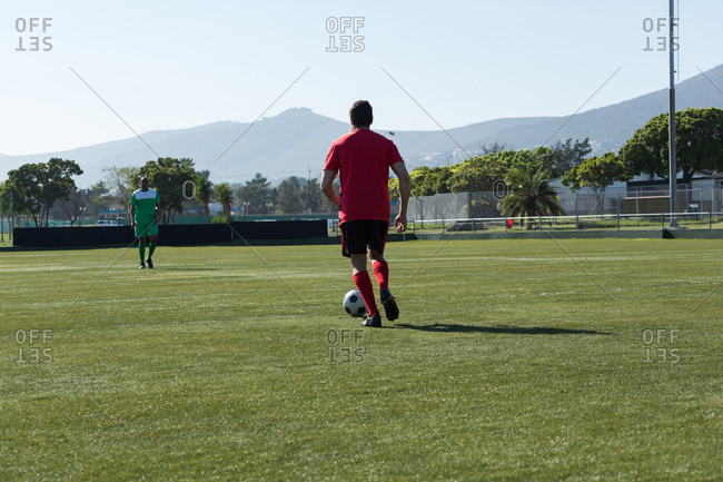 Player playing football soccer game on sports field