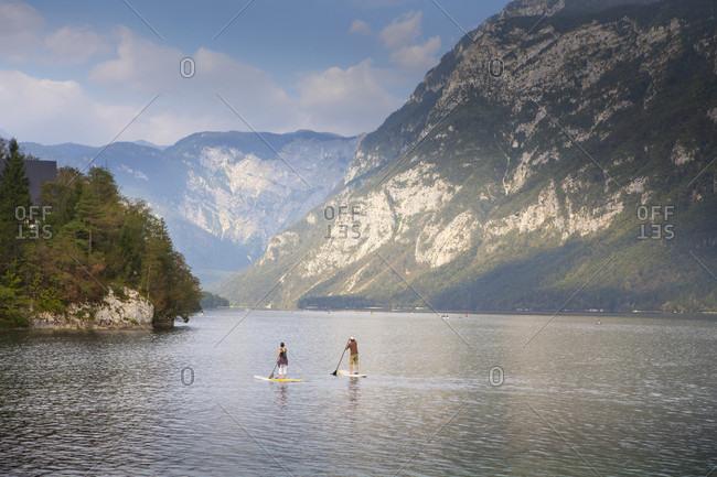 September 4, 2016: A couple paddling at Lake Bohinj, Ribcev Laz, Triglav, Slovenia