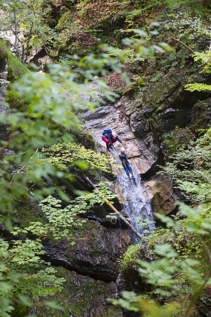 September 8, 2016: Canyoning in narrow gorge filled with rapids, pools and waterfalls in Soca valley near Bovec, Slovenia