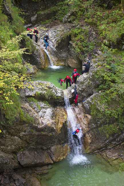 September 8, 2016: Canyoning in a narrow gorge filled with rapids, pools and waterfalls in the Soca valley near Bovec, Slovenia.