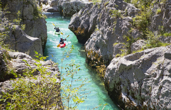 September 8, 2016: Kayakers on the emerald Soca near Bovec in Slovenia. This green colored river, originating in the Triglav mountains, is famous for all kinds of white water activities.