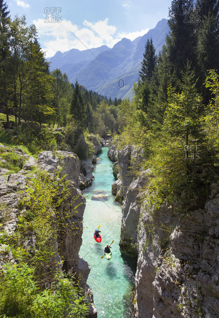 September 8, 2016: Kayakers on Soca river originating in Trigval mountains. The river is famous for all kinds of white water activities, Triglav National Park, Slovenia