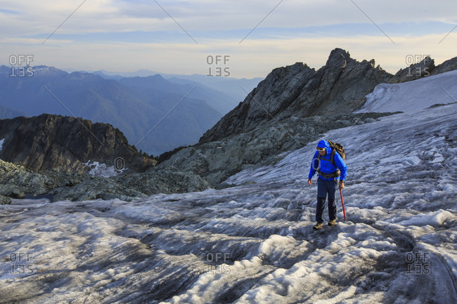 August 18, 2015: Mountain climber on glacier at Mount Shuksan, North Cascades National Park, Washington State, USA