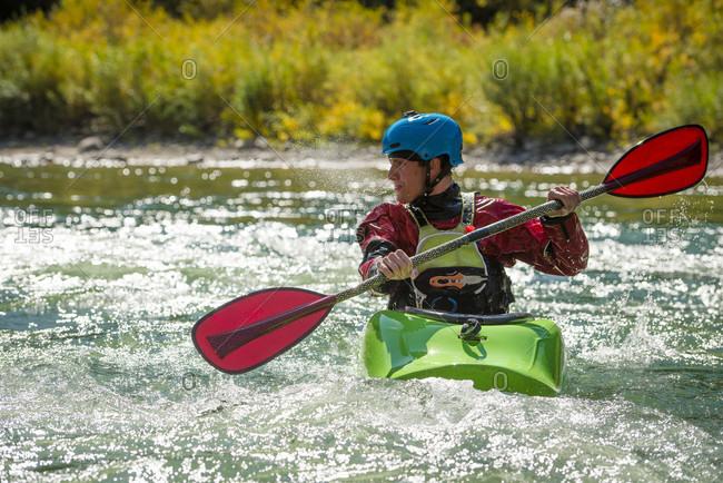 September 20, 2016: Male kayaker paddling on Snake River, Jackson, Wyoming, USA