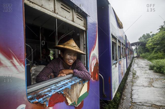 July 26, 2017: Local passengers ride Yangon Central Railway, Myanmar