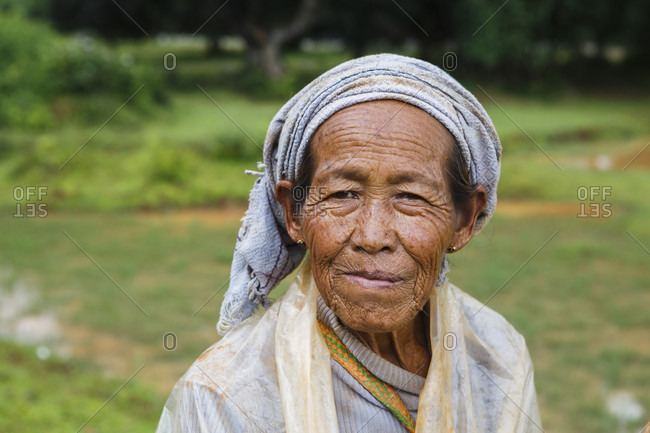 July 16, 2017: Portrait of senior female farmer standing outdoors and looking at camera, Shan State, Myanmar