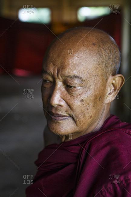 July 15, 2017: Portrait of senior monk looking away, Shan State, Myanmar