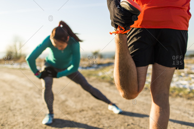 December 2, 2014: Two runners stretching, Discovery Park, Seattle, Washington State, USA