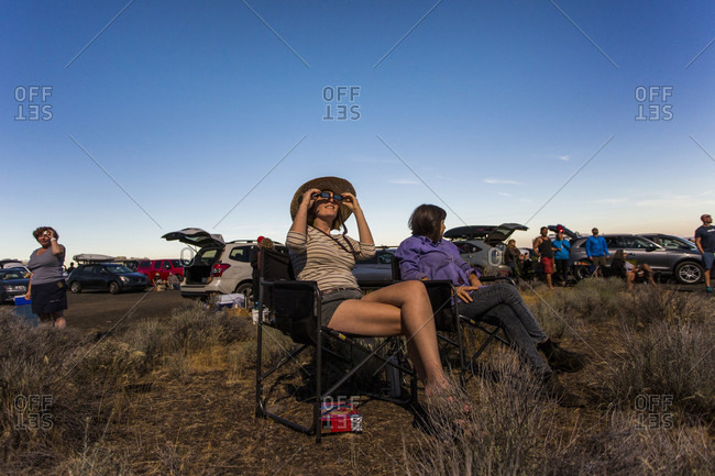 August 21, 2017: Woman watching solar eclipse, August 8, 2017, Maupin, Oregon, USA