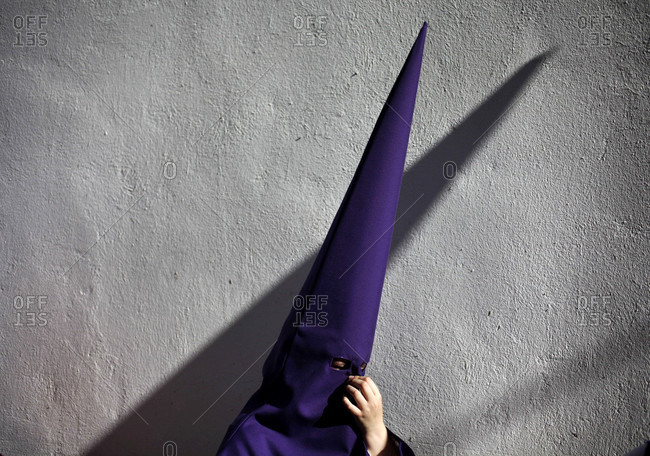 April 12, 2017: Penitent wearing pointed hood during Easter Week celebrations in Baeza, Jaen Province, Andalusia, Spain