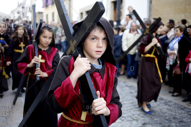 April 14, 2017: Boys and girls carrying crosses during Easter Week celebrations in Baeza, Jaen Province, Andalusia, Spain