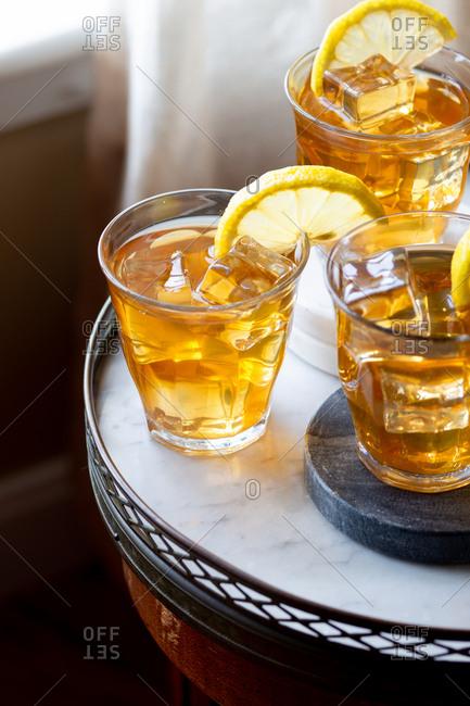 Iced tea with lemon on a marble top table