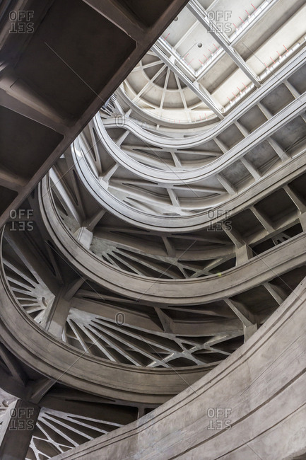 Turin, Piedmont, Italy - May 11, 2018: Lingotto building (this building once housed an automobile factory built by Fiat), view of the helical ramp that was used to move cars up to a higher level, the elevated track at the top of the former Fiat Lingotto factory
