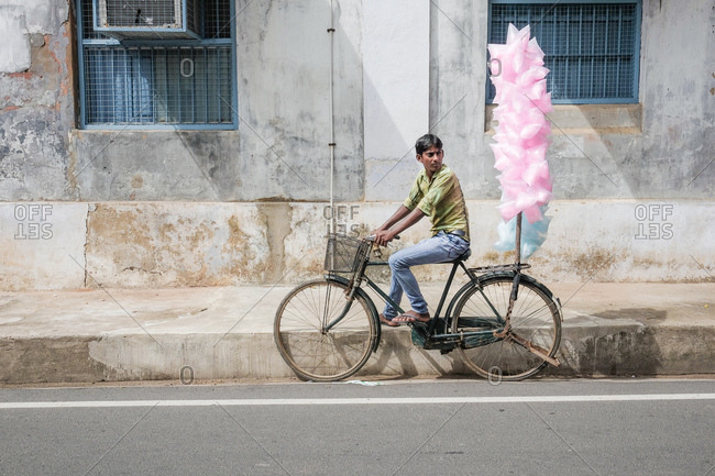 Pondicherry, India - December 7, 2016: Man selling cotton candy on a bike