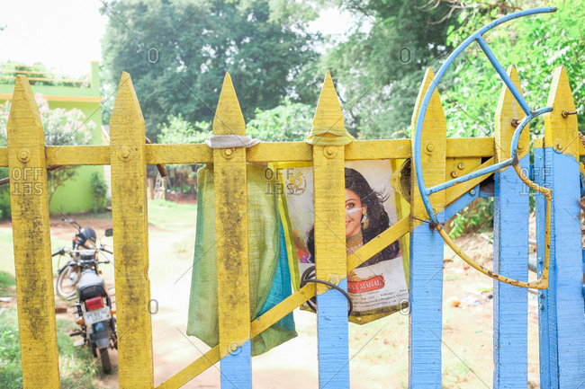 Pondicherry, India - December 7, 2016: Blue and yellow fence