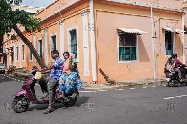 Pondicherry, India - December 7, 2016: Family riding on motorbike