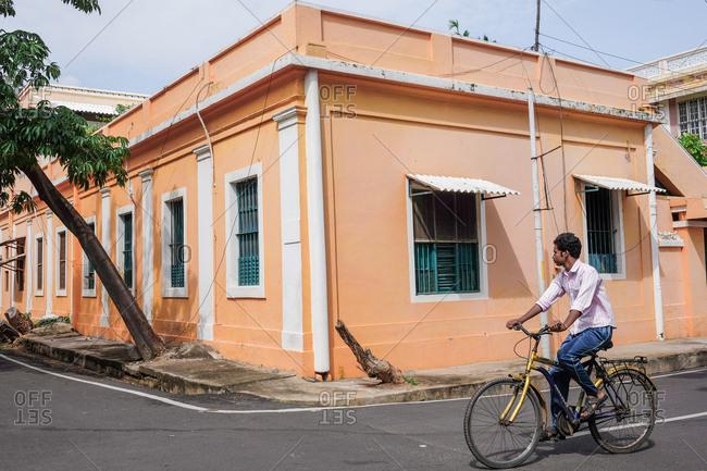 Pondicherry, India - December 7, 2016: Man riding bicycle on city street