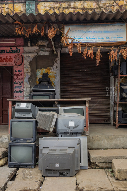 Pondicherry, India - December 7, 2016: Old televisions outside of an electronics repair shop