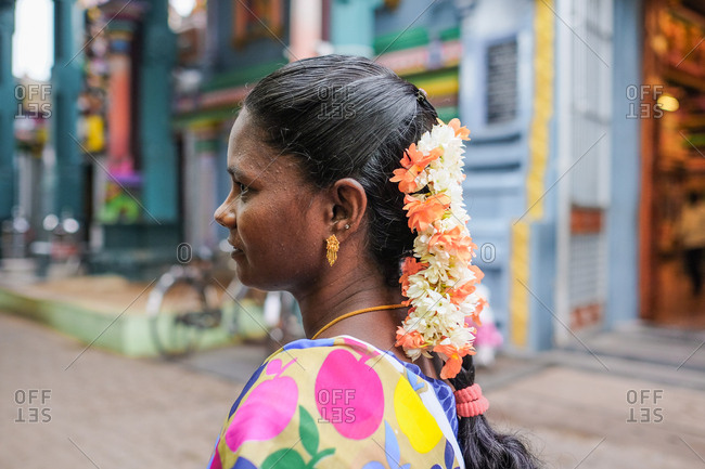 Pondicherry, India - December 7, 2016: Profile portrait of a woman wearing colorful traditional Indian clothing