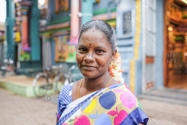 Pondicherry, India - December 7, 2016: Portrait of a woman wearing colorful traditional Indian clothing