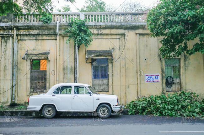 Pondicherry, India - December 7, 2016: Old white car parked in street