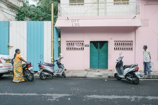 Pondicherry, India - December 7, 2016: Street scene with people and scooters