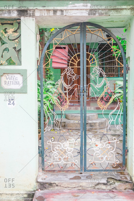 Pondicherry, India - December 7, 2016: Metal gate with horses