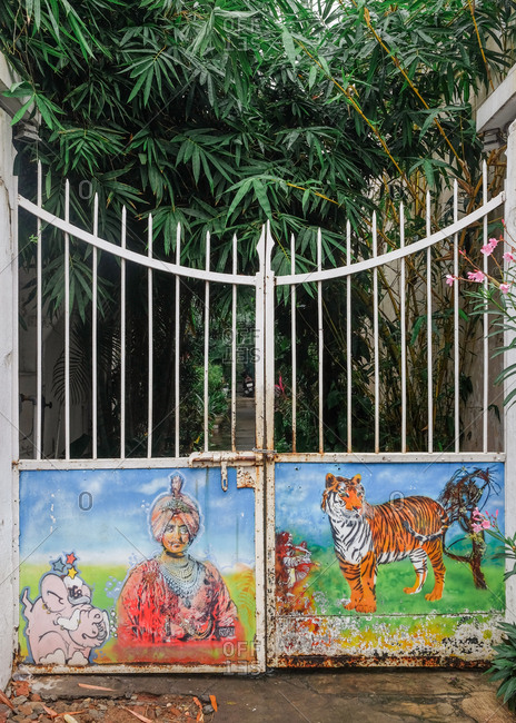 Pondicherry, India - December 7, 2016: Colorful painting on iron gate