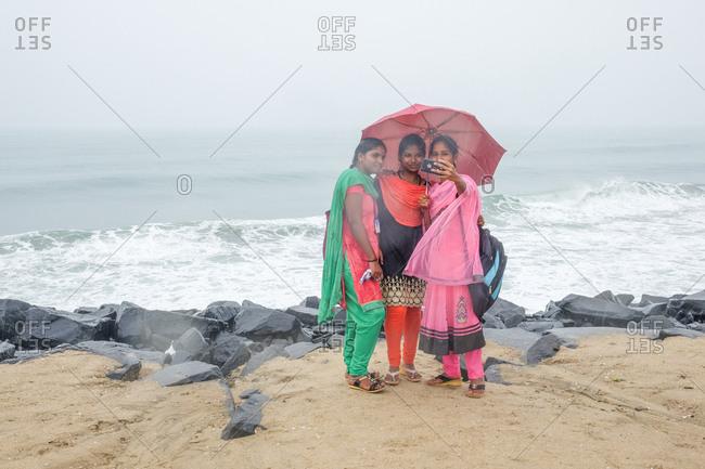 Pondicherry, India - December 7, 2016: Women taking selfie by ocean