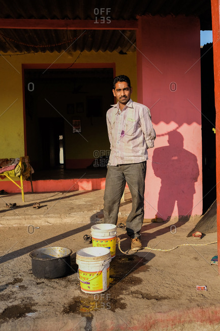 Saputara, India - November 24, 2016: Man standing outside colorful building