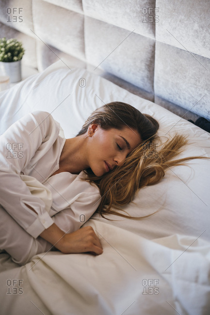 Close up of young woman asleep with hair in face