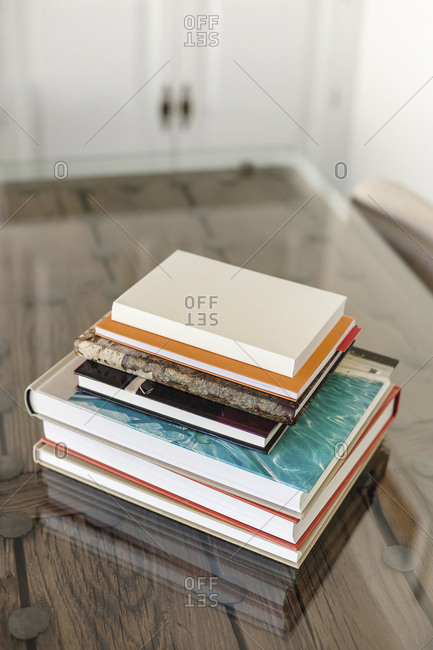 Books stacked on handcrafted table in modern flat