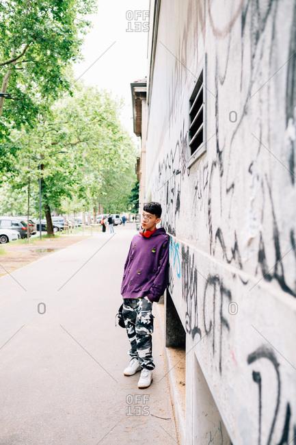 Young Asian man posing outdoors