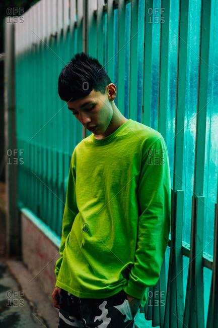 Young Asian man outdoors at night