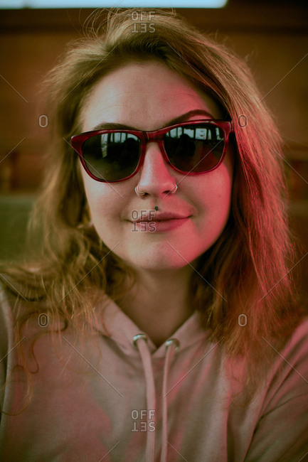 Portrait of a young woman wearing sunglasses