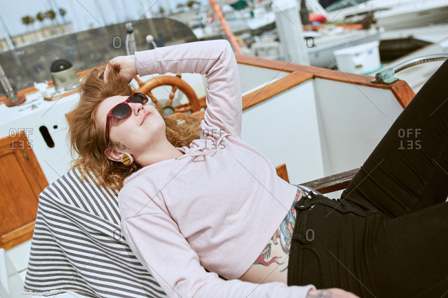 Young woman relaxing on sailboat