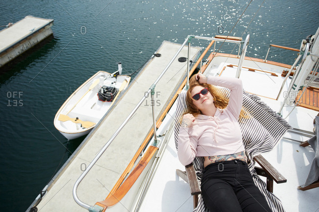 Young woman lounging on boat