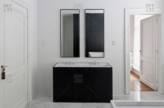 Sink area and mirrors in modern bathroom