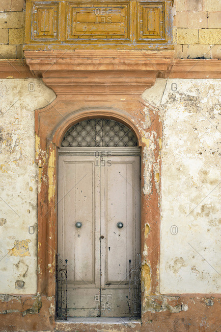 Old arched doorway of a building in Malta