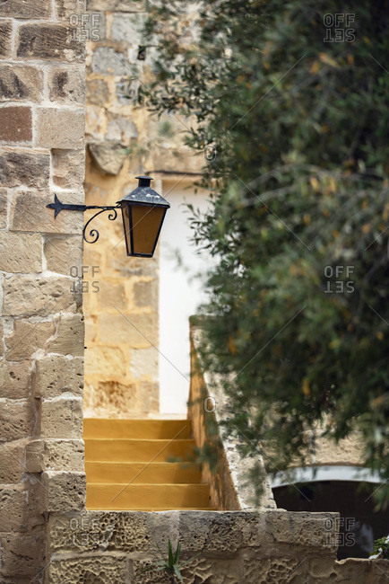 Old lamp on a building in Malta