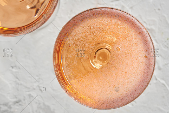 Glass of pink champagne being poured