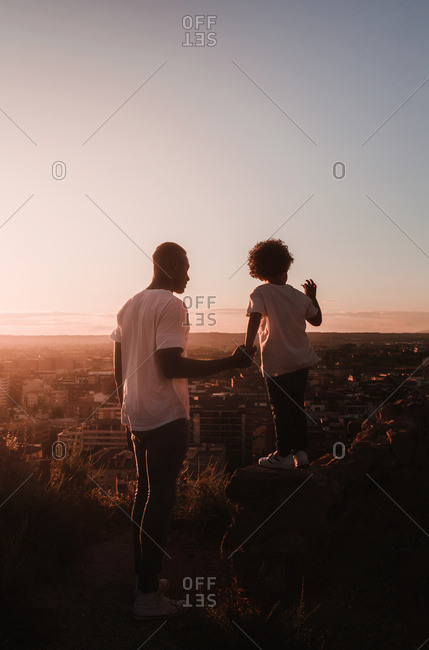 African father and his son observes the city horizon