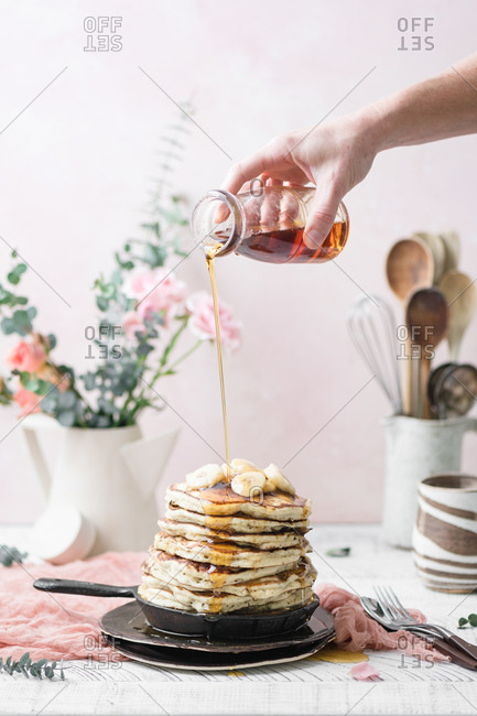 Vegan Banana Pancakes topped with Maple Syrup.