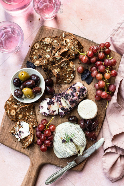 Cheese Board with goat cheese, grapes, and olives